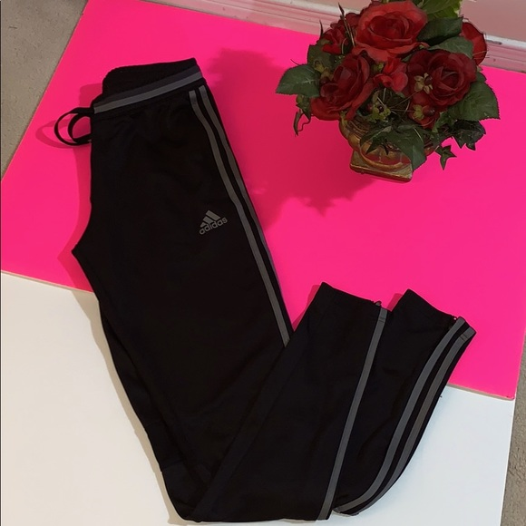 Adidas track pants with stripe on the side